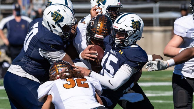 Stony Point quarterback Skylar Hausenfluck is tackled by Zane Bolding and a Hutto teammate. Hutto won a District 25-6A football game 29-9 over Stony Point at Kelly Reeves Athletic Complex on Saturday.