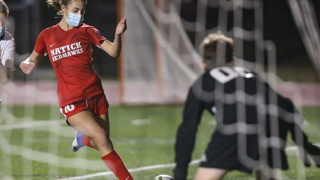 Natick's Natick sophomore Eliza Campana shoots and scores during the girls soccer game against Needham at Natick High School on Friday, Oct. 23, 2020.