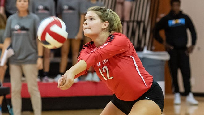 Vista Ridge outside hitter Savannah McCune, returning the ball against Round Rock, plans to attend college and either become a labor and delivery nurse or a hospice nurse.