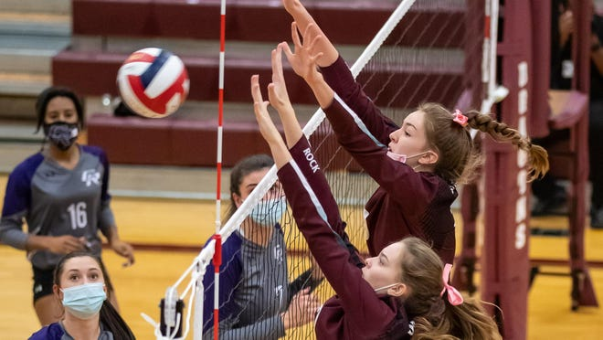Lauren Murphy and Kelly Swyers of Round Rock combine for a block against Cedar Ridge earlier this season. The Dragons, who are still in contention for the District 25-6A title, face rival Westwood twice in the final week of the regular season.