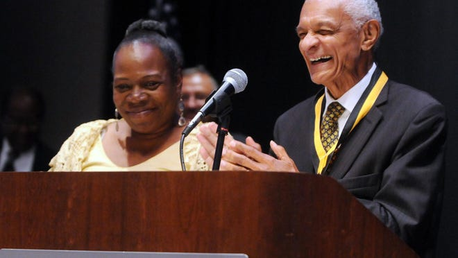 The Rev. Dr. C.T. Vivian is awarded the President Lyndon B. Johnson Civil and Human Rights Legacy Award as Rhonda Bellamy looks on at the LBJ Presidential Civil-Human Rights Legacy Awards Luncheon in 2014.