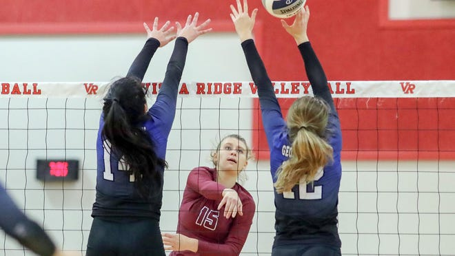 Rouse outside hitter Emery Reid powers a ball through Georgetown blockers during the teams' matchup Wednesday. Reid finished the regular season with 229 kills, 26 blocks, 248 digs and 32 aces.