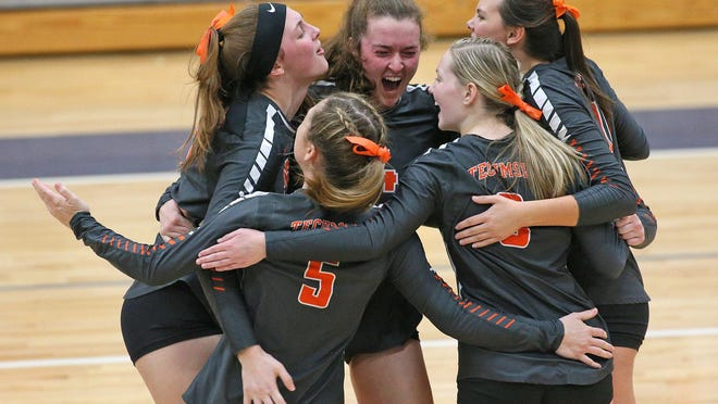 The Tecumseh volleyball team celebrates a set victory during the 2019 season.