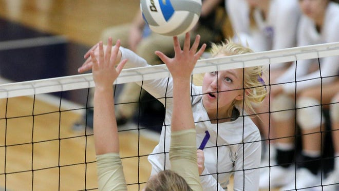 Onsted's Kinsey Wanger swings for a kill during a match in the 2019 volleyball season.
