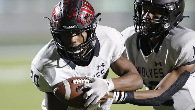 Weiss running back Devin Cross, taking a handoff from quarterback Dior Bradfield in the Nov. 6 game against Pflugerville, rushed for 316 yards and three TDs in a victory over Manor, earning American-Statesman player of the week honors.