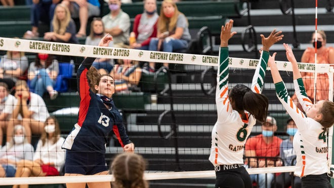 Wimberley's Paige Crawford, left,  taking a shot against Georgetown Gateway earlier this season, slammed 19 kills and served two aces to lead Wimberley past Bellville 25-18, 18-25, 25-23, 25-18 in a state semifinal Tuesday at Cuero High School.