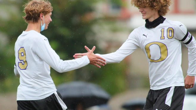 Onsted's Brennan Goodrow (10) and Alexander Slaviero (9) celebrate a goal during Monday's game at Clinton.