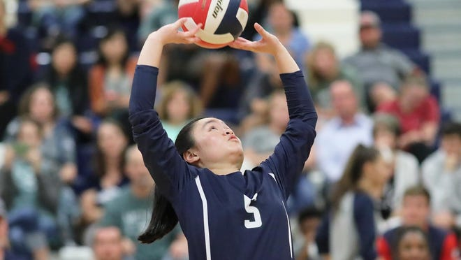 "McNeil setter Sara Hong, making a pass during a match last season against Vista Ridge, said volleyball has taught her how to be confident in herself. ""Results may not be immediate, but hard work eventually pays off for those who don't give up,"" she said."