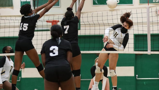 Kings Mountain's Aaliyah Byers fires a shot past Ashbrook defenders and into a void for a kill during Tuesday's match.