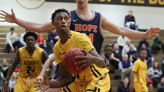 Adrian College forward Kendall Bellamy handles the ball during a game against Hope in the 2019-20 season.