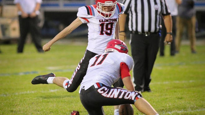 Clinton kicker Jonathan Baughey (19) kicks a ball held by David Campbell (11) during a LCAA game against Dundee on Oct. 9.