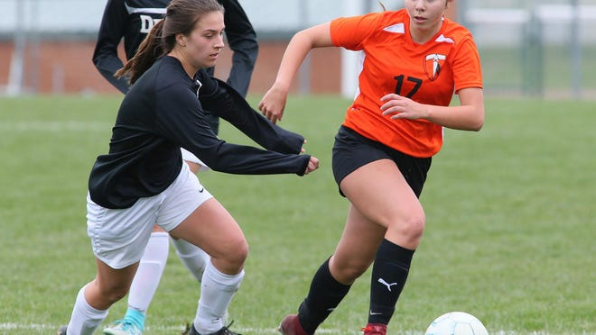 Tecumseh's Sydney Slusarski pushes the ball up field during a match against Dexter in 2019.