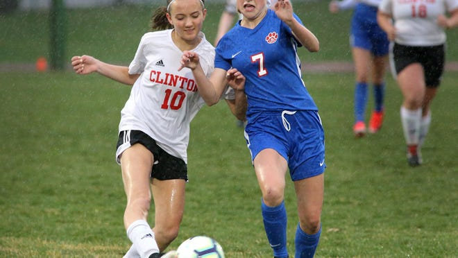 Clinton forward Sky Chandler (10) shoots as Lenawee Christian's Lauren Melton (7) defends during their Independent Soccer League game on April 18, 2019.