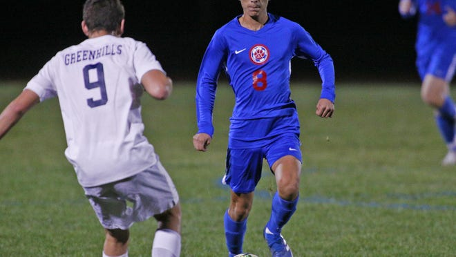 Lenawee Christian's Francisco Cabrera handles the ball during a district game against Ann Arbor Greenhills in the 2019 season.