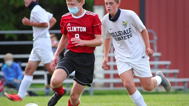 Clinton's Garret Handy pushes the ball up the field during a game against Hillsdale on Monday.