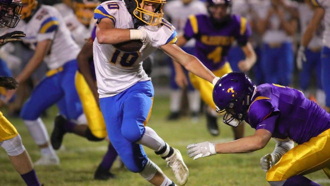 Luke Levicki carries the ball for Ida last season. The Blue Streaks open with five of their first seven games on the road, including a game at Ida on Sept. 2 meeting with Whiteford. Those teams have not played since 1976.