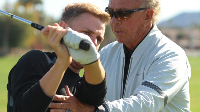 College of the Desert golf coach Tony Manzoni works with player sophomore Chris Cotton on Tuesday, February 11, 2104 in Palm Desert.