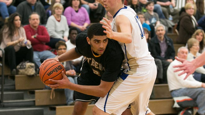 Anthony Lamb of Greece Athena is defended by Webster Schroeder's Chris McKrell during Friday's game in Webster.