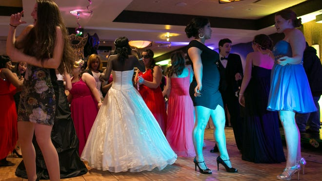 Patients and their dates dance at the third annual Golisano Children's Hospital Prom at the Strathallan in Rochester on Saturday.