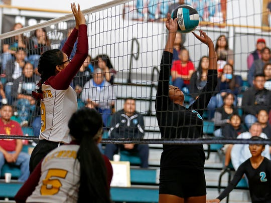 Navajo Prep's Jasmine Coleman sets the ball during