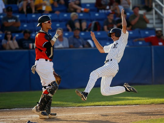East Cobb Yankees' Billy Zinnershine slides past Dallas Tigers' Jaxx Groshans to score a run Wednesday in Game 19 of the Connie Mack World Series at Ricketts Park in Farmington.
