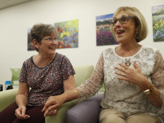 Sister Adele O'Sullivan (left) and Annette Stein talk Aug. 9, 2018, about how they helped create Circle the City's new Phoenix facility.