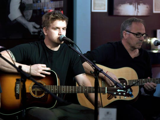 Nashville singer-songwriter Levi Hummon warms up for a songwriting round event with his father, songwriter Marcus Hummon, at the Bluebird Cafe on April 5, 2018.