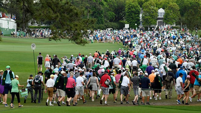 Patrons leave the course during a weather warning  at the 2019 Masters Tournament. The 2021 Masters Tournament will have a limited number of patrons in attendance.