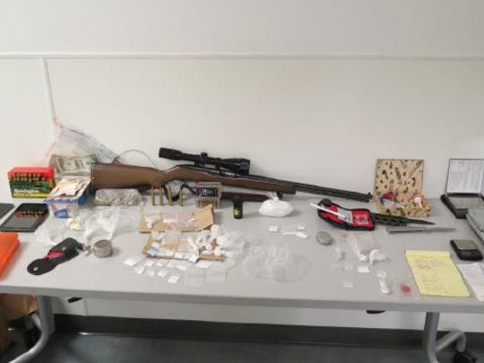 Authorities seized an array of weapons and narcotic sales paraphernalia at a Greenfield home.