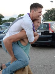 Caleb Balgaard gives a piggyback ride to Justin McKay as the two start their night of fellowship and fun at Highland Township's Cornerstone Church.
