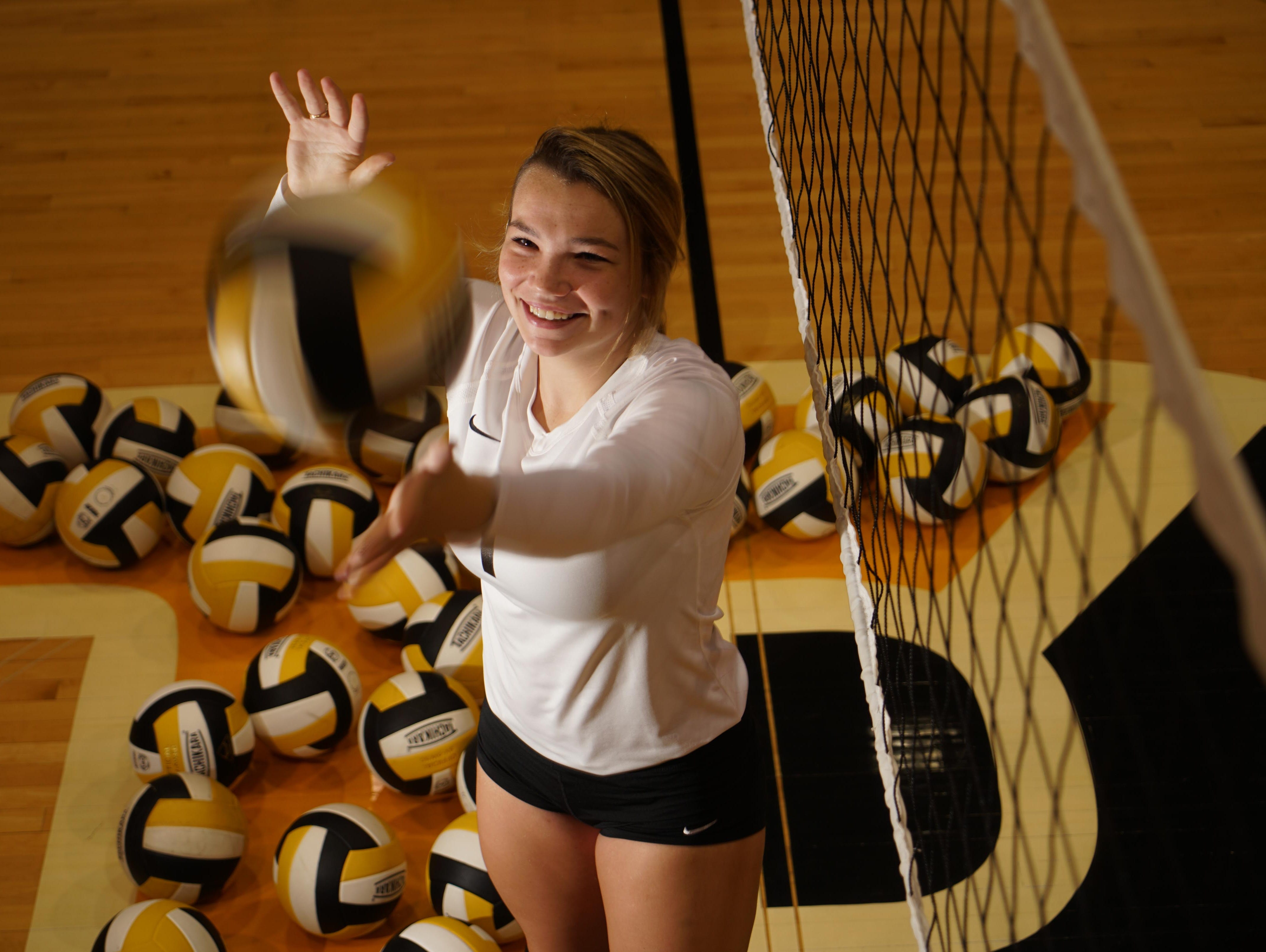17 year-old Madelyn Judge, a senior, a volleyball for Padua Academy.