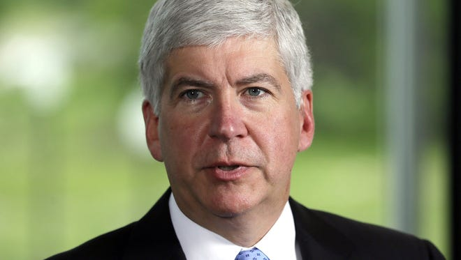 Gov. Rick Snyder on Tuesday signed legislation eliminating straight-ticket voting in Michigan, but encouraged the Legislature to pass legislation to allow for no-reason absentee voting in Michigan.