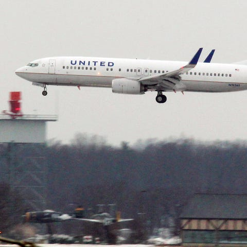 In this Feb. 1 photo, a United Airline jet...