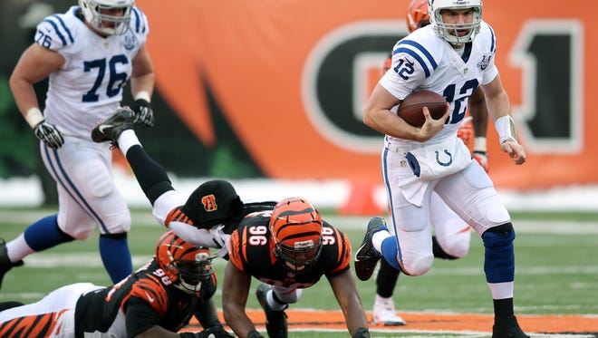 Indianapolis Colts quarterback Andrew Luck breaks into a run in the second half of the game at Paul Brown Stadium on Sunday, December 8, 2013. The Colts lost 42-28 to the Bengals.