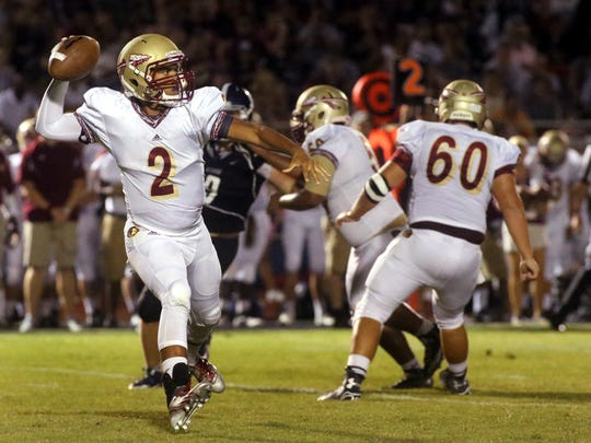 Riverdale's Cortland Owens pulls back to pass the ball during the week zero game against Siegel at Siegel, on Friday,  August  22, 2014.