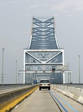 A firm involved in a legal dispute over painting the Commodore Barry Bridge in Logan faces criminal charges in connection with two projects in Philadelphia.