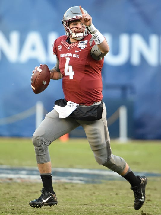 File-This Dec. 27, 2016, file photo shows Washington State quarterback Luke Falk (4) looking for a receiver during the first half of the Holiday Bowl NCAA college football game in San Diego. Falk arrived at Washington State as a walk-on and mostly unknown. He's about to begin his senior season for the 24th-ranked Cougars with a chance to rewrite the Pac-12 record book as the latest in a lineage of star quarterbacks on the Palouse. (AP Photo/Denis Poroy, File)