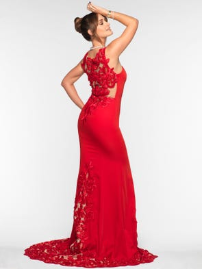 Laura wears a red private label fitted evening gown