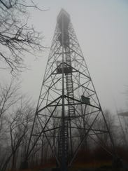 The Nimham Mountain Fire Tower is shrouded in fog.