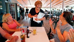 Maine's first lady Ann LePage chats with diners after
