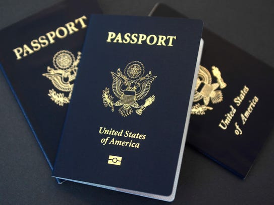 U.S. passports lie on a table.