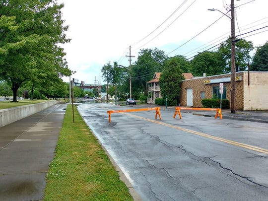 A stretch of Henry Street in Binghamton was blocked off Tuesday due to flooding.