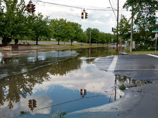 A stretch of Henry Street in Binghamton was blocked off because of flooding Tuesday.
