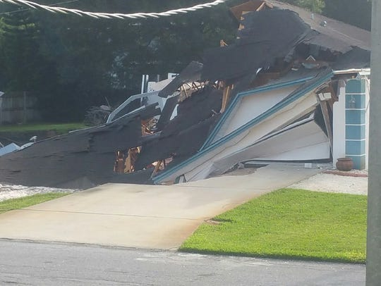 A home was destroyed by a sinkhole Friday in Pasco