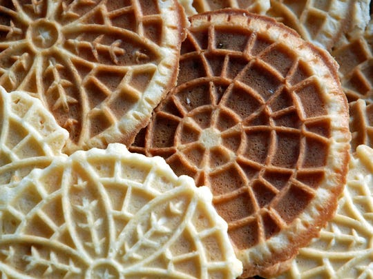 Make these cookies with a vintage Pizzelle iron from the 1800s.