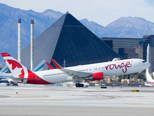 A rouge Boeing 767 leaves the warm climate Las Vegas,