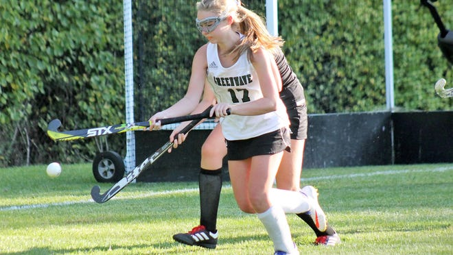 Dover High School's Molly Goodridge tries to settle the ball while being closely guarded during a Sept. 21 field hockey game in Dover.