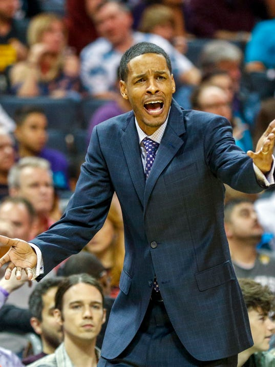 Charlotte Hornets assistant coach Stephen Silas argues for a foul call against the Milwaukee Bucks in the first half of an NBA basketball game in Charlotte, N.C., Saturday, Dec. 23, 2017. (AP Photo/Nell Redmond)