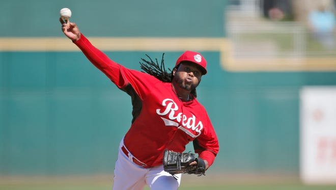 Reds starting pitcher Johnny Cueto delivers to the plate during the second inning against the Cleveland Indians, Thursday, March 5, 2015, in Goodyear, Arizona.