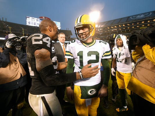 Aaron Rodgers, Charles Woodson
